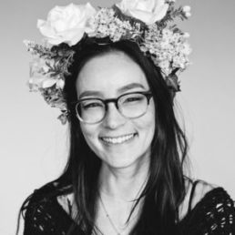woman in flower crown smiling
