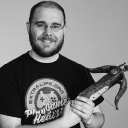 Man holding a small crossbow