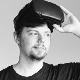 Man lifting a VR headset off him