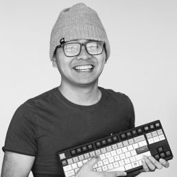 man posing with a keyboard